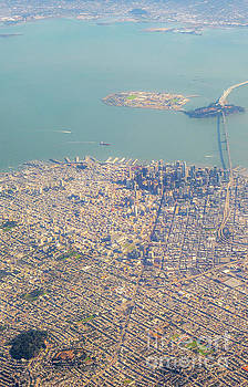 Aerial View of Large Bridge Leaving San Francisco with Sunny Day by PorqueNo Studios