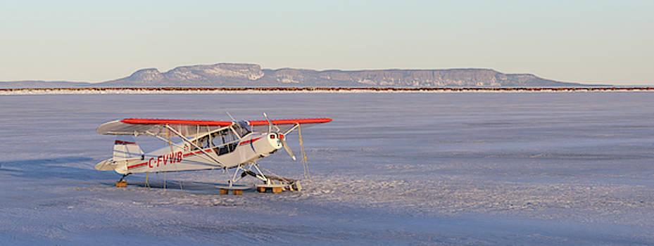 Airplane in the harbour by Jakub Sisak