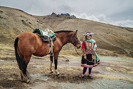 An indigenous Quechua woman with her horse in Peru by Kamran Ali