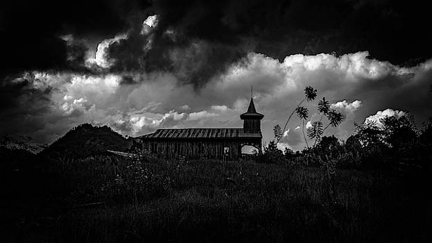 Ancient Wooden Church With Storm Clouds by Chris Lord