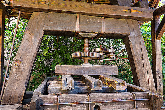 Antique wooden wine press in Alsace - France by Paul MAURICE