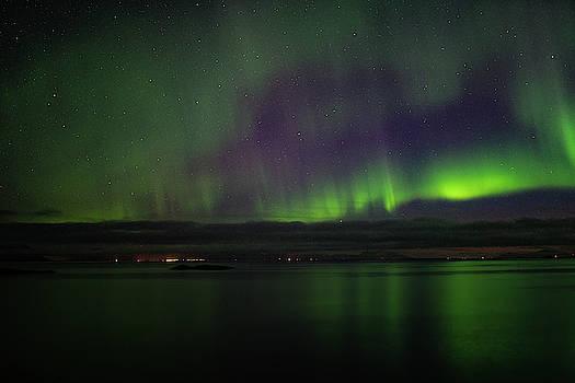 Aurora Borealis reflecting at the sea surface by Kai Mueller