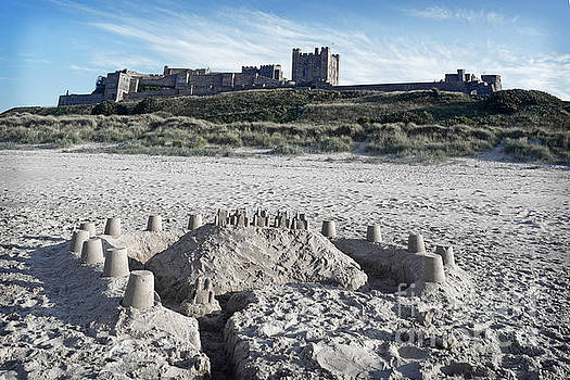 Bamburgh Castle and beach. by David Birchall