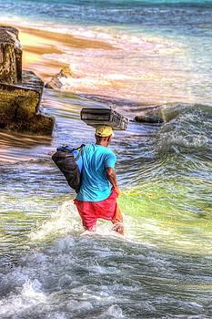 Barbados Beach Seller In Heavy Surf by David Pyatt