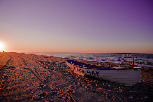 Beach sunset with boat capemay by Alan Rizzolo
