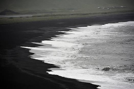 Black beach by Norman Burnham