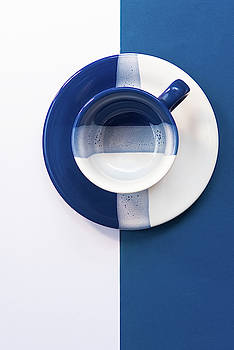 Blue and White empty coffee mug by Michalakis Ppalis
