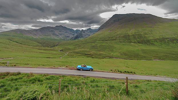 Blue car Cuillin Mountains by Fabio Gomes Freitas