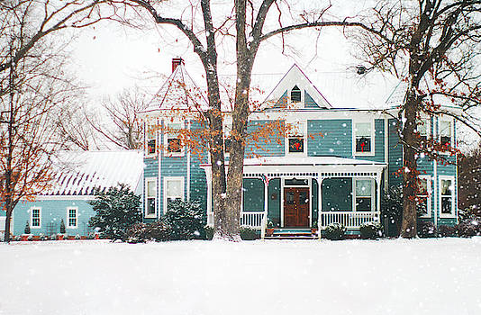 Blue Victorian Farm House At Christmas In The Snow  by Suzanne Powers