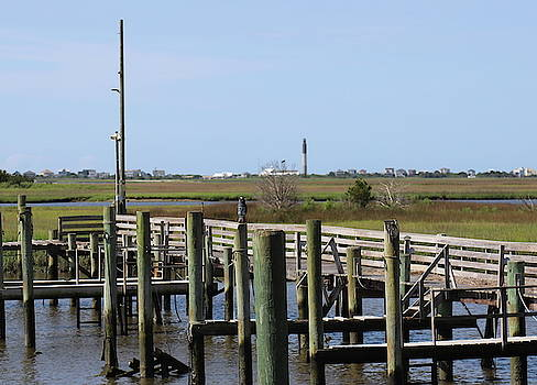 Boat Docks And Oak Island Lighthouse by Cathy Lindsey