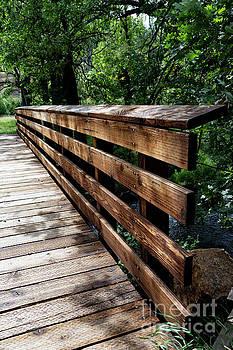 Bridge over creek by Carol Bilodeau