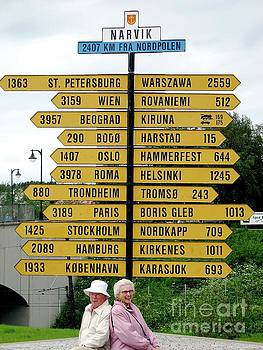 Bruce and Phyllis in Narvik signs to many places by Phyllis Kaltenbach