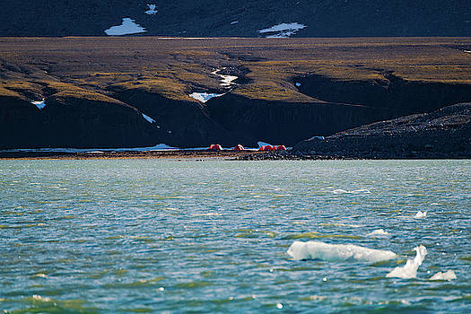 Campsite tents in Svalbard at midnight by Kai Mueller