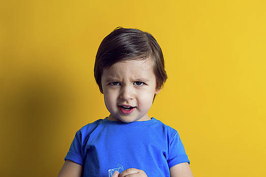 Cheerful Baby Boy In Blue T-shirt Stands by Elena Saulich