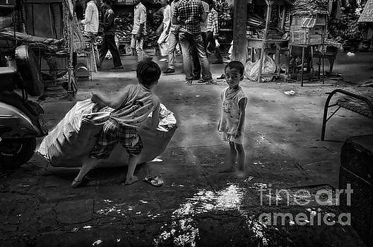 Child labour in the streets by Stefano Senise