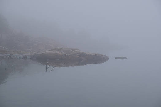Cliffs in fog by Magnus Haellquist