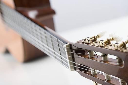 Close-up Of A Guitar by Jamie Grill