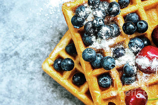 Close-up of a waffle with blueberries for breakfast during a vac by Joaquin Corbalan
