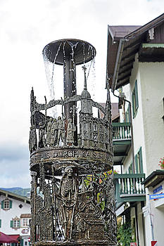 Closeup Of A Fountain That Is In Oberammergau Germany by Richard Rosenshein