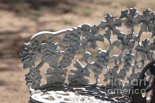 Closeup of Ornate Grape Pattern of Iron Seat by Colleen Cornelius