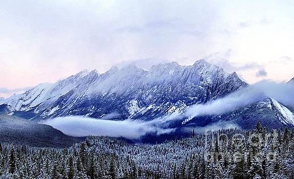 Campwillowlake - Clouds and a dusting of snow on mountains in Banff National Park