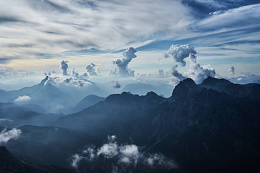 Moody Cloudy Mountains with a lot of contrast and shadows and clouds by Lukas Kerbs