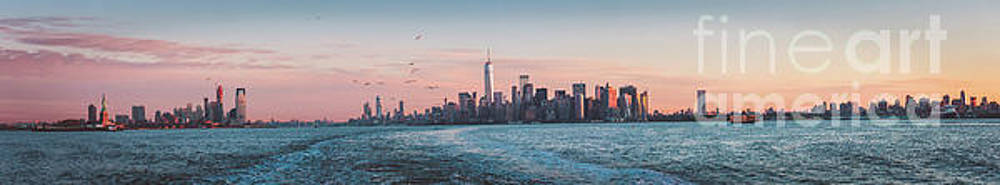Colorful Sunrise Over the New York Skyline and The Statue of Lib by PorqueNo Studios