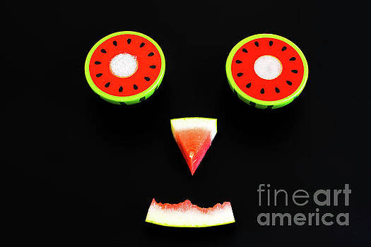 Composition of a funny face made with fruit, smile of a watermel by Joaquin Corbalan