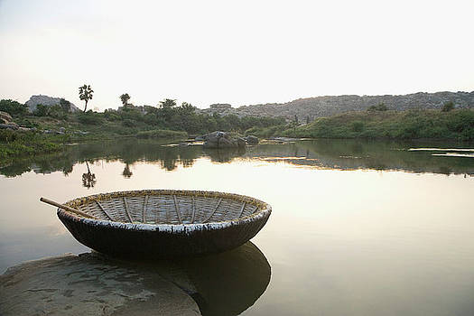 Coracle At The Bank Of A River by Exotica.im
