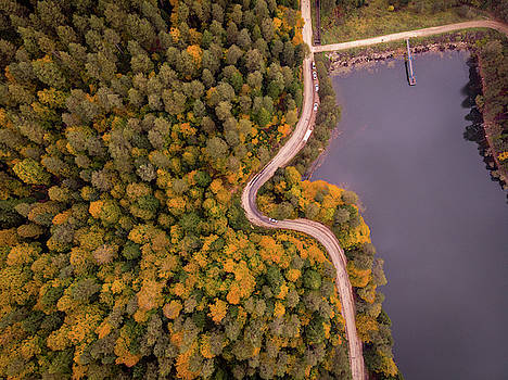 Curved road at lakeside by Okan YILMAZ