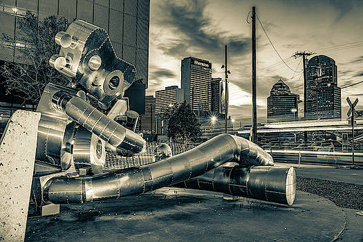 Dallas Traveling Man and Skyline - Sepia Edition by Gregory Ballos