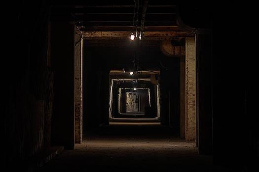 Dark tunnel by Steev Stamford