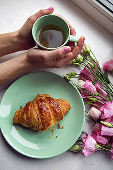 Decoration On The Window Of The Girl's Hand Holding A Mug Of Tea And Croissants by Elena Saulich