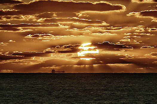 Dramatic Atlantic Sunrise with Ghost Freighter in Goldtone by Bill Swartwout Fine Art Photography
