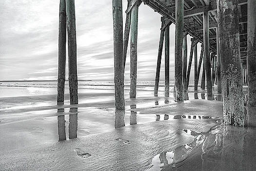 Dramatic Pier Sunrise in Black and White by Betsy Knapp