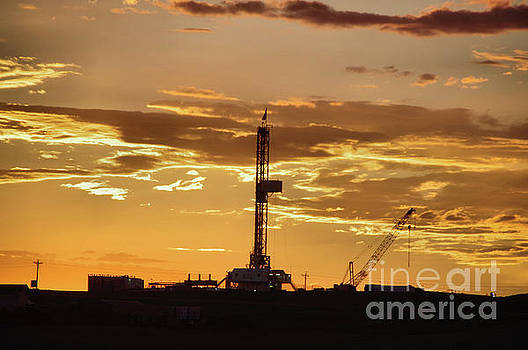 Drilling in the sunset by Jeff Swan