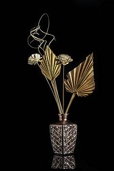 Dry flowers on a modern metal vase creating a beautiful abstract by Michalakis Ppalis