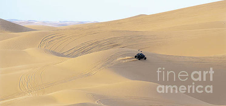 Dune buggy Crests the Top of a Hill by Daniel Ryan