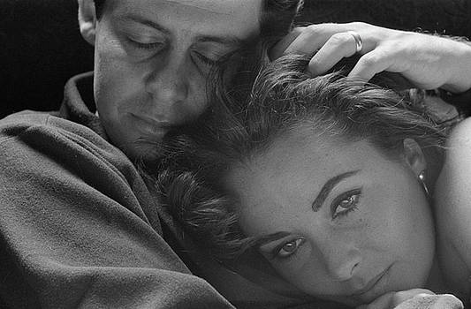 Elizabeth Taylor With Head On Her Husband Eddie Fisher      by Toni Frissell