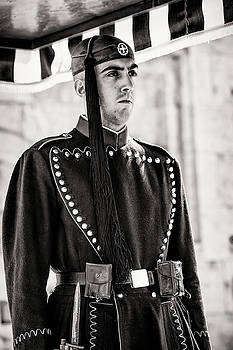 Evzone Standing Guard at Unknown Soldier Memorial Athens by Lenochka Blonsky