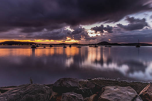 First Light with Heavy Rain Clouds on the Bay by Merrillie Redden