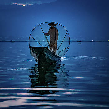 Fisherman At First Light On Inle Lake by Chris Lord