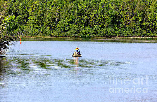 Fisherman in a traditional canoe on the Trent Severn Waterway by Louise Heusinkveld