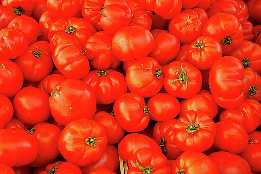 Fresh tomatoes in the market by Steve Estvanik
