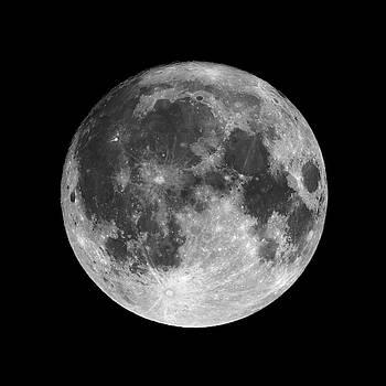 Full moon isolated on black night sky background by Lukasz Szczepanski