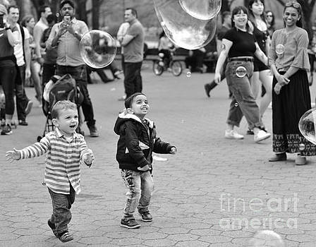 Fun with Bubbles - Central Park in Spring by Miriam Danar