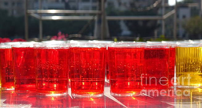 Glasses Filled with Red Liquid by Yali Shi