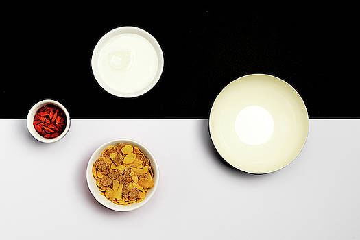 Group ceramic bowls with healthy cereal breakfast by Michalakis Ppalis