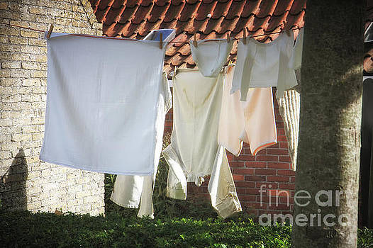 Hanging laundry in the wind by Jan Brons