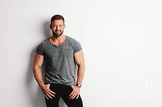 Happy handsome man on white background. by Michal Bednarek